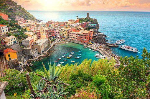 Vernazza is a town in Cinque Terre, Italy. Vernazza is filled with colourful houses and lies in front of a small harbor which attracts a lot of photographers with its beauty.