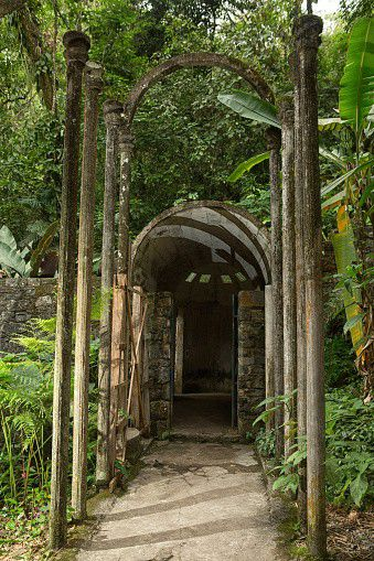 Las Pozas consists of a surreal group of structures created by Edward James, more than 2,000 feet above sea level, in a subtropical rainforest in the mountains of Mexico. It encompasses over 80 acres of natural waterfalls and pools intertwined with towering surreal concrete sculptures.