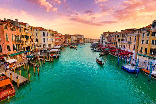 Grand Canal, Venice, Italy. The inner-city Grand Canal is almost three hundred feet wide and stretches for almost two and a half miles. There can be up to five thousand boats a day navigating the waters. Venice consists of almost 262.000 inhabitants and is the capital of the province of Venice.