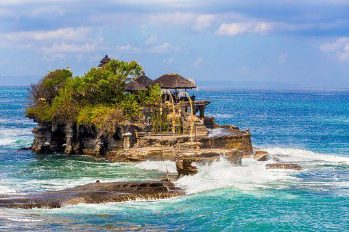 Tanah Lot is fully called Pura Tanah Lot and this temple is partly in the sea and you cannot really go there for most of the day. Tanah lot is built on a kind of rock island. Only when it is low tide you can visit Tanah Lot. The Pura Tanah Lot is Bali's most photographed and visited temple.